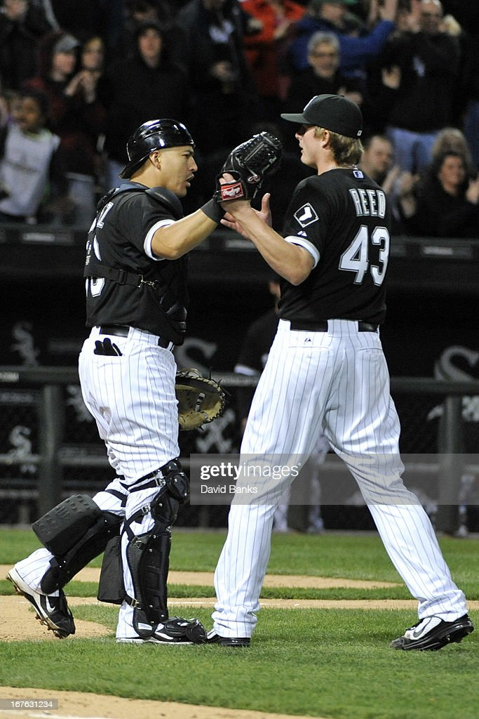 Hector Gimenez #38 and Addison Reed #43 of the Chicago White Sox celebrate a win against the Tampa Bay Rays on April 26, 2013 at U.S. Cellular Field in Chicago, Illinois. The Chicago White Sox defeated the Tampa Bay Rays 5-4.