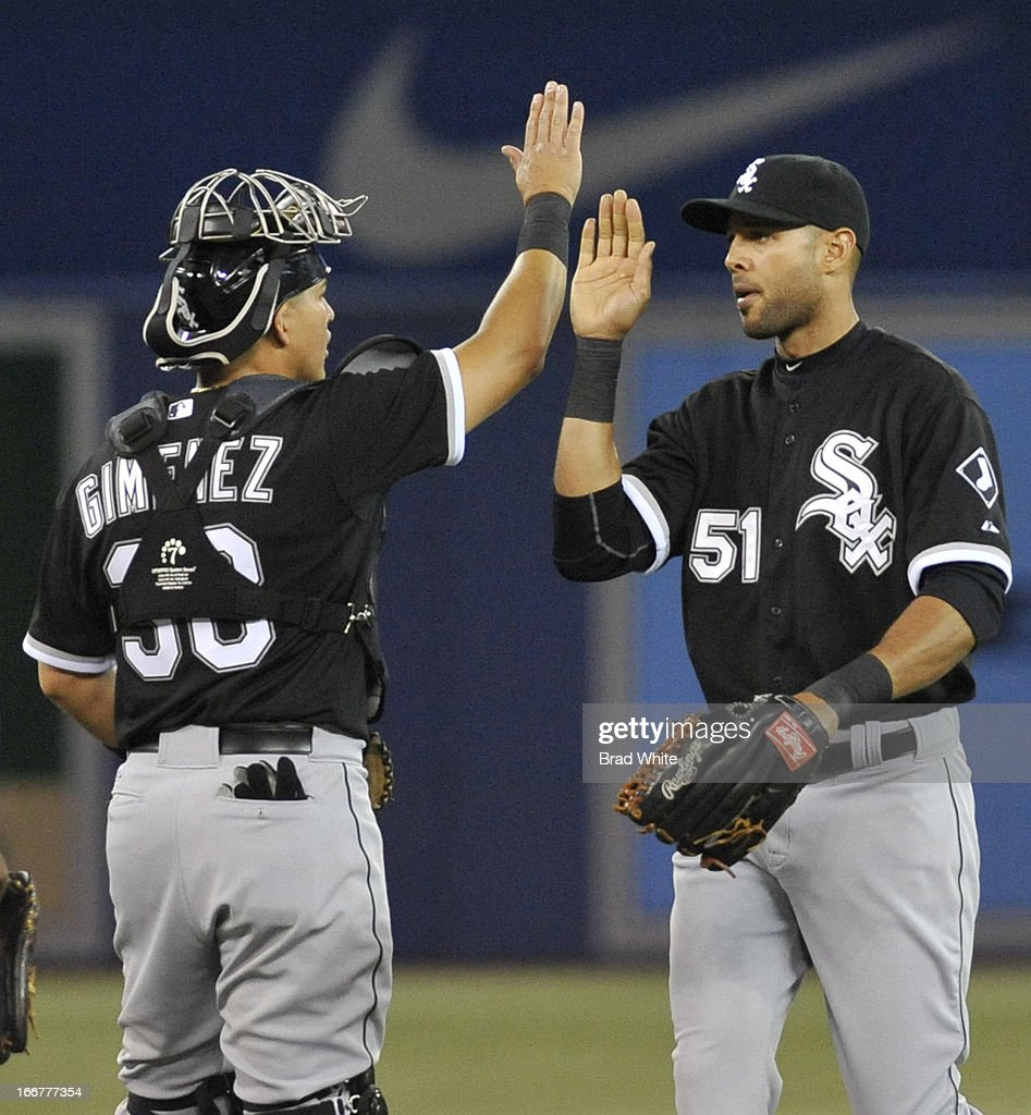 Hector Gimenez #38 and <a gi-track='captionPersonalityLinkClicked' href=/galleries/search?phrase=Alex+Rios&family=editorial&specificpeople=224676 ng-click='$event.stopPropagation()'>Alex Rios</a> #51 of the Chicago White Sox celebrate the team's win over the Toronto Blue Jays during MLB game action April 16, 2013 at Rogers Centre in Toronto, Ontario, Canada.