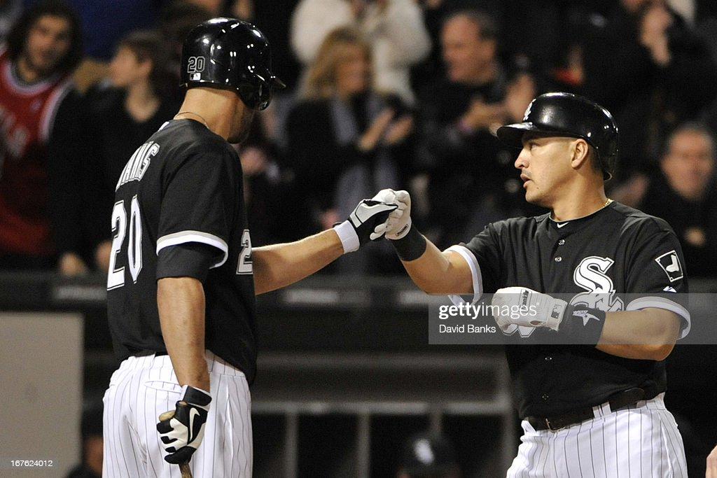 Hector Gimenez #38 of the Chicago White Sox is greeted by Jordan Danks #20 after hitting a home run against the Tampa Bay Rays during the fifth inning on April 26, 2013 at U.S. Cellular Field in Chicago, Illinois.