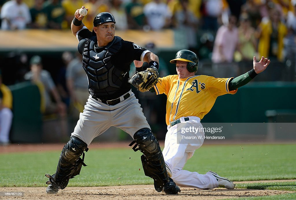 Hector Gimenez #38 of the Chicago Whites Sox gets the force out at home on <a gi-track='captionPersonalityLinkClicked' href=/galleries/search?phrase=Josh+Donaldson&family=editorial&specificpeople=4959442 ng-click='$event.stopPropagation()'>Josh Donaldson</a> #20 of the Oakland Athletics and throws to first base for a double-play in the ninth inning at O.co Coliseum on June 1, 2013 in Oakland, California. The Athletics won the game 4-3 in extra inning on a bases loaded walk to Josh Reddick #16.