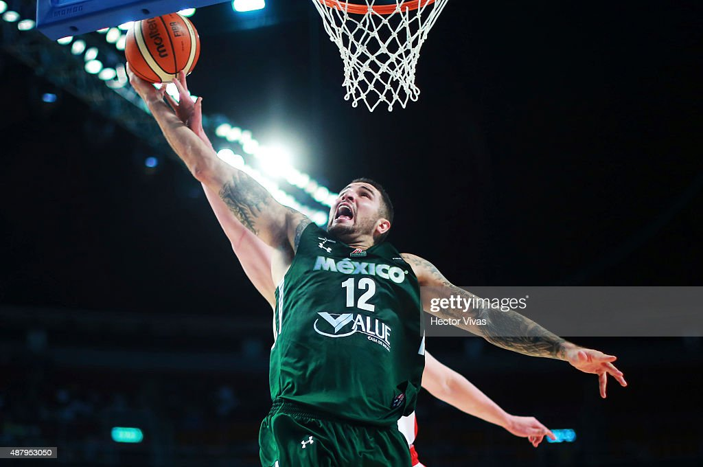 Hector Hernandez of Mexico goes up against <a gi-track='captionPersonalityLinkClicked' href=/galleries/search?phrase=Kelly+Olynyk&family=editorial&specificpeople=5953512 ng-click='$event.stopPropagation()'>Kelly Olynyk</a> of Canada during a third place match between Canada and Mexico as part of the 2015 FIBA Americas Championship for Men at Palacio de los Deportes on September 12, 2015 in Mexico City, Mexico.