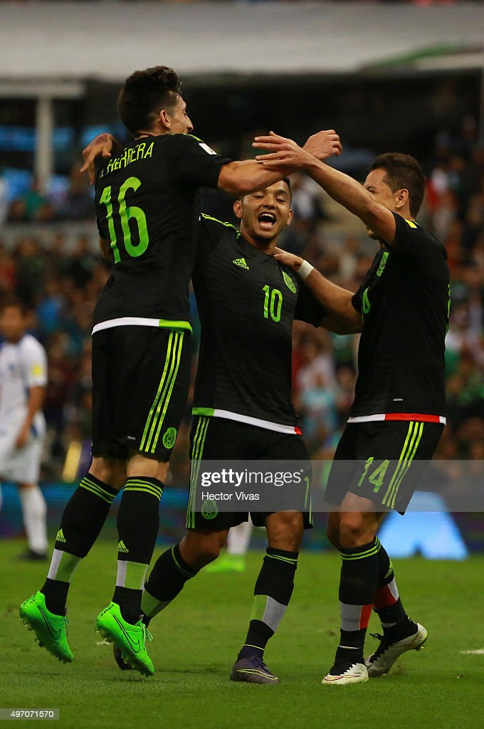Hector Herrera celebrates with teammates after scoring the second goal of his team during the match between Mexico and El Salvador as part of the 2018 FIFA World Cup Qualifiers at Azteca Stadium on November 13, 2015 in Mexico City, Mexico.