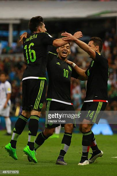 Hector Herrera celebrates with teammates after scoring the second goal of his team during the match between Mexico and El Salvador as part of the...