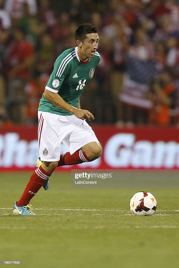 Hector Herrera moves the ball during a match between United States and Mexico as part of the CONCACAF Qualifiers at Columbus Crew Stadium on September 10, 2013 in Columbus, United States.