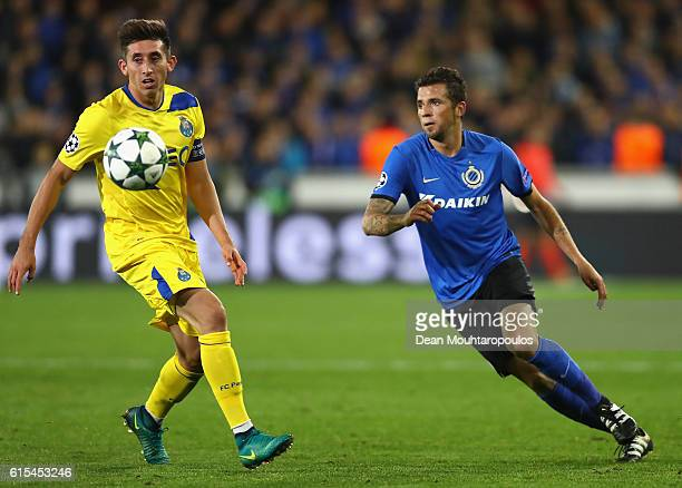 Hector Herrera of FC Porto and Claudemir of Club Brugge compete for the ball during the UEFA Champions League Group G match between Club Brugge KV...