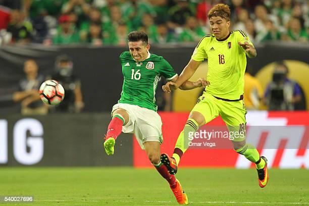 Hector Herrera of Mexico and Adalberto Peñaranda of Venezuela run for the ball during a group C match between Mexico and Venezuela at NRG Stadium as...