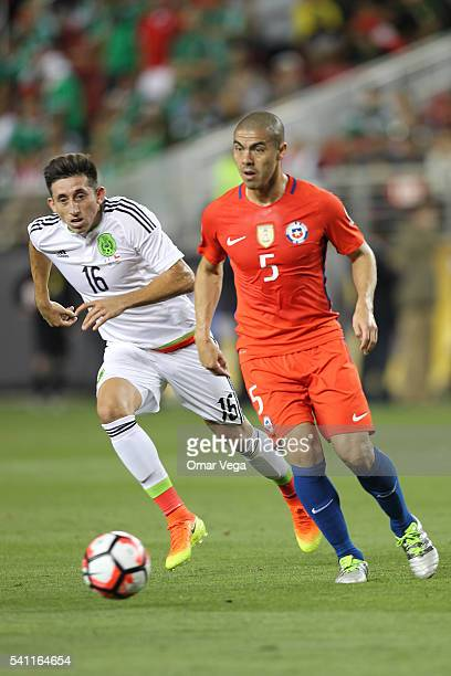 Hector Herrera of Mexico and Francisco Silva of Chile fight for the ball during a Quarterfinal match between Mexico and Chile at Levi's Stadium as...