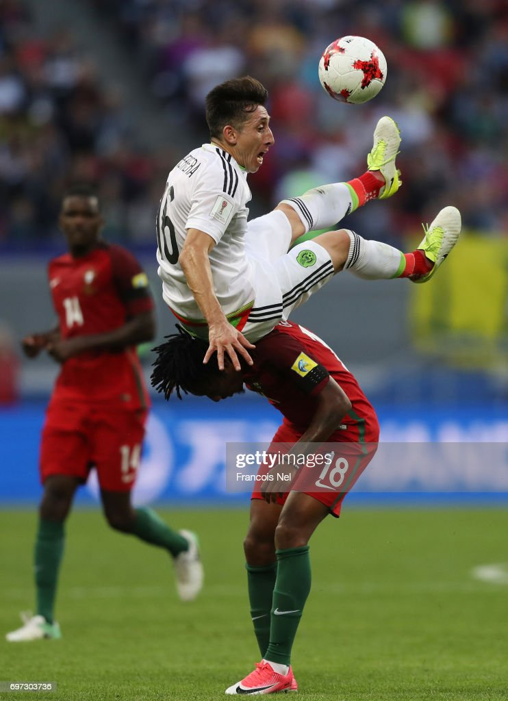 Hector Herrera of Mexico and Gelson Martins of Portugal compete for the ball during the FIFA Confederations Cup Russia 2017 Group A match between Portugal and Mexico at Kazan Arena on June 18, 2017 in Kazan, Russia.