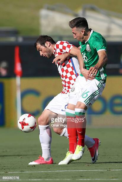 Hector Herrera of Mexico and Ivan Santini of Croatia compete for the ball during an International Friendly match between Mexico and Croatia at Los...