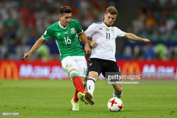 Hector Herrera of Mexico and Timo Werner of Germany compete for the ball during the FIFA Confederations Cup Russia 2017 SemiFinal between Germany and...
