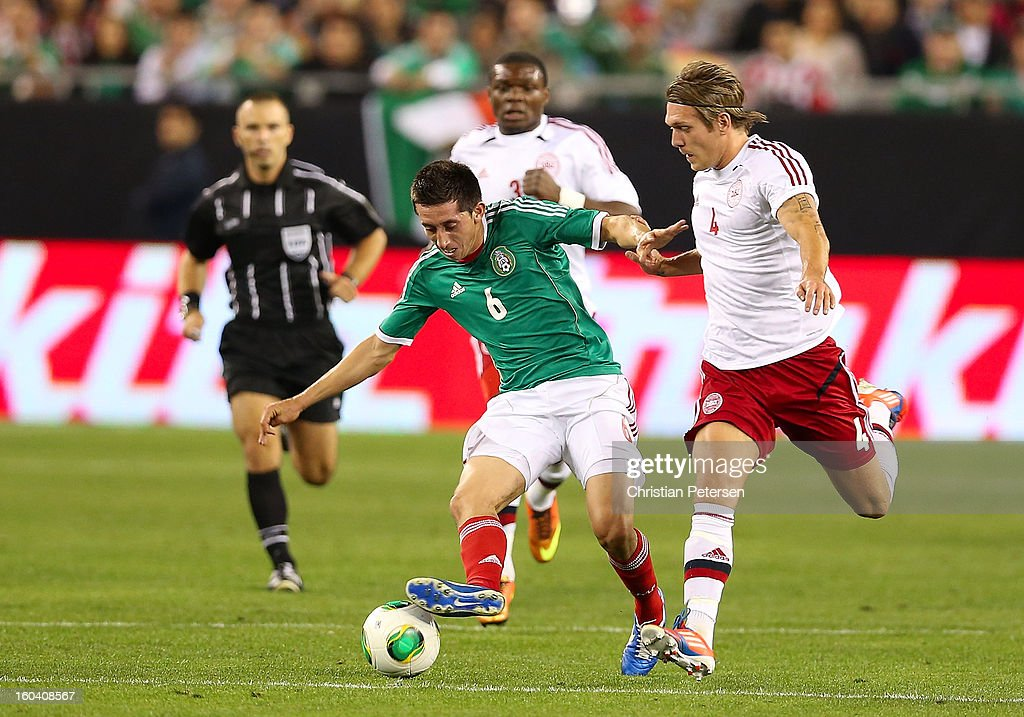Hector Herrera #6 of Mexico attempts to control the ball under pressure from Kris Stadsgaard #4 of Denmark during an international friendly match at University of Phoenix Stadium on January 30, 2013 in Glendale, Arizona. Mexico and Denmark ended in a 1-1 draw.