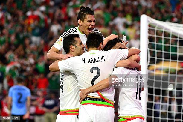 Hector Herrera of Mexico celebrates with teammates after scoring a goal in extra time during the 2016 Copa America Centenario Group C match against...