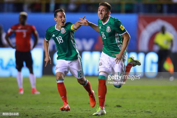Hector Herrera of Mexico celebrates with teammates after scoring the third goal of his team during the match between Mexico and Trinidad Tobago as...