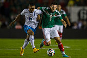 Hector Herrera of Mexico fights for the ball with Fernando Garrido of Honfuras during a friendly match between Mexico and Honduras at Victor Manuel...