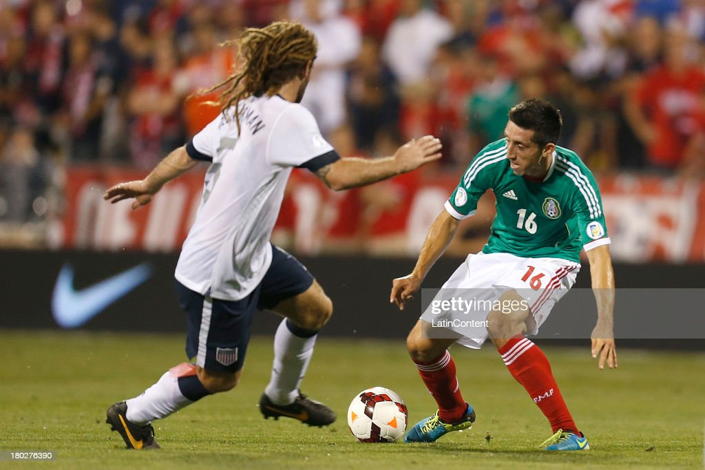 Hector Herrera of mexico tries to dribble an opponent during a match between United States and Mexico as part of the CONCACAF Qualifiers at Columbus Crew Stadium on September 10, 2013 in Columbus, United States.