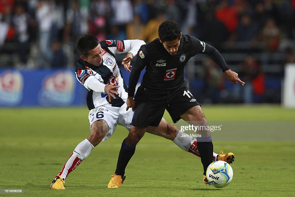 Hector Herrera of Pachuca struggles for the ball with Alejandro Vela of Cruz Azul during the Clausura 2013 Liga MX at Hidalgo Stadium on February 16, 2013 in Pachuca, Mexico.