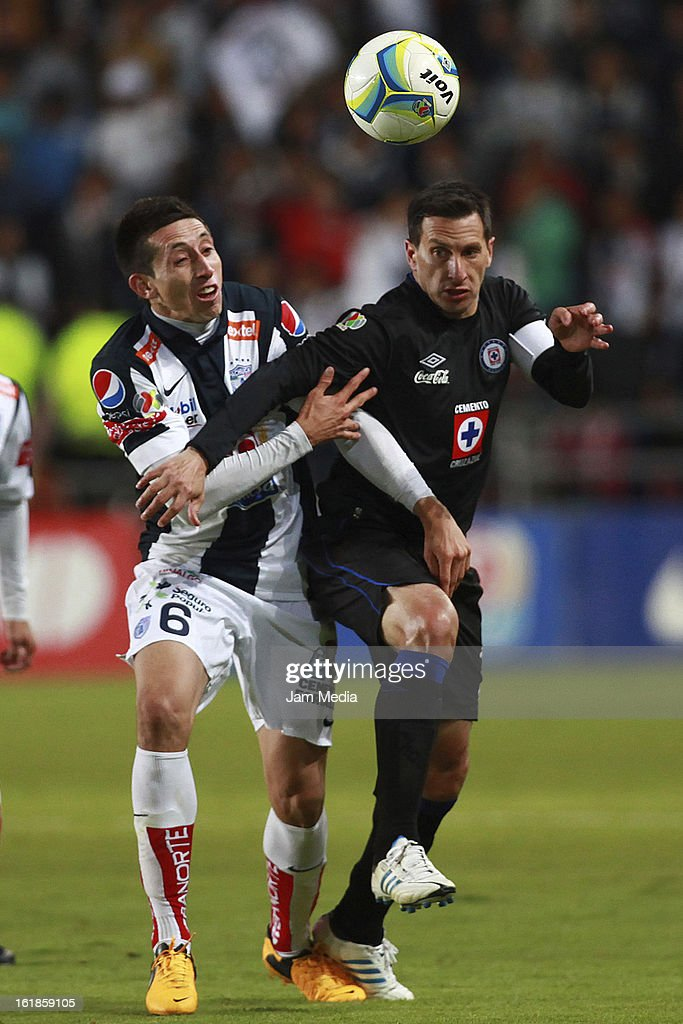 Hector Herrera of Pachuca struggles for the ball with Christian Gimenez of Cruz Azul during the Clausura 2013 Liga MX at Hidalgo Stadium on February 16, 2013 in Pachuca, Mexico.