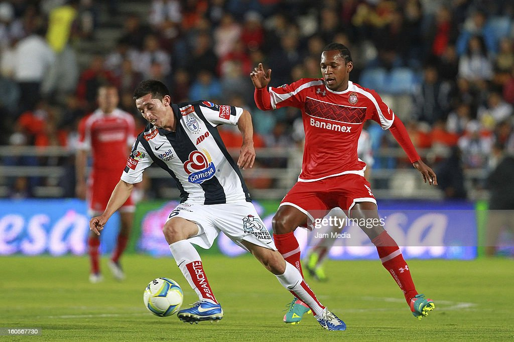 Hector Herrera (L) of Pachuca struggles for the ball with Wilson Tiago (R) of Toluca during the Clausura 2013 Liga MX at Hidalgo Stadium on february 2, 2013 in Pachuca, Mexico.