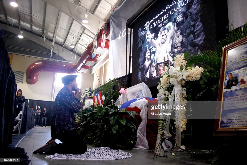 Hector 'Machito' Camacho Jr prays for his late father Hector 'Macho' Camacho in a public memorial service at Department of Sports and Recreation on November 28, 2012 in San Juan, Puerto Rico. Camacho died after being removed from life support following a November 20, 2012 shooting in Bayamon, Puerto Rico.