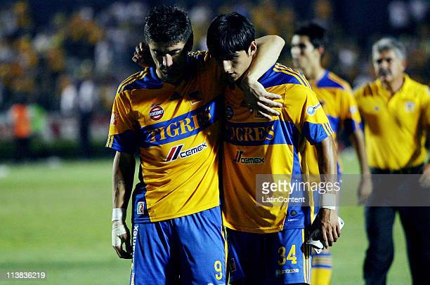 Hector Mancilla and Alan Pulido of Tigres reacts during a quarter finals match as part of the Clausura Tournament 2011 at Universitario Stadium on...
