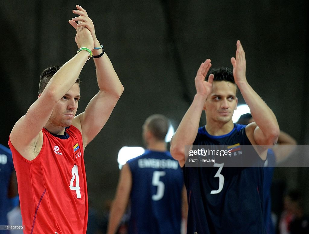 Hector Mata and Fernando Gonzales of Venezuela celebrate after winning the match during the FIVB World Championships match between Venezuela and Cameroon on September 2, 2014 in Wroclaw, Poland.