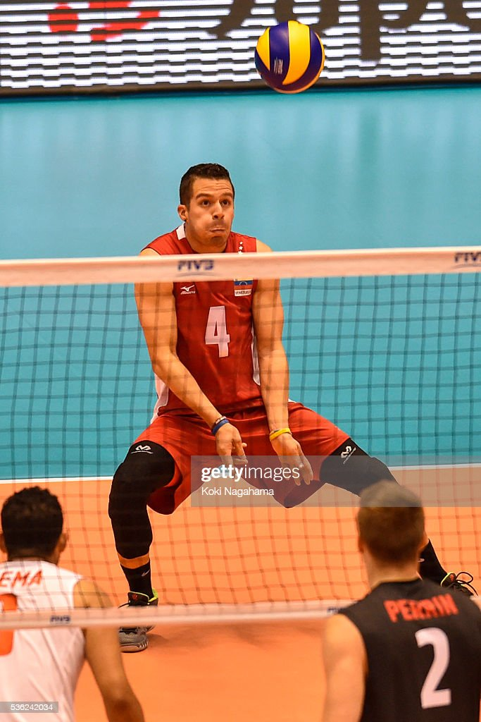 Hector Mata #4 of Venezuela receives the ball during the Men's World Olympic Qualification game between Venezuela and Canada at Tokyo Metropolitan Gymnasium on June 1, 2016 in Tokyo, Japan.