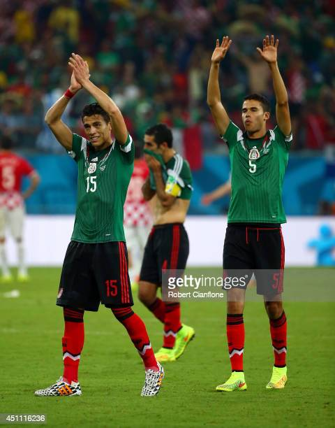 Hector Moreno and Diego Reyes of Mexico acknowledge the fans after a 31 victory in the 2014 FIFA World Cup Brazil Group A match between Croatia and...