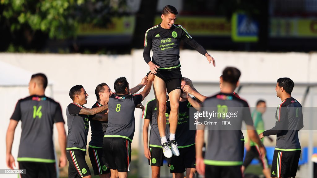 Hector Moreno is lifted up into the air by his team mates during a Mexico press conference at Fisht Olympic stadium ahead of their FIFA Confederations Cup Russia 2018 semi-final match against Germany on June 28, 2017 in Sochi, Russia.
