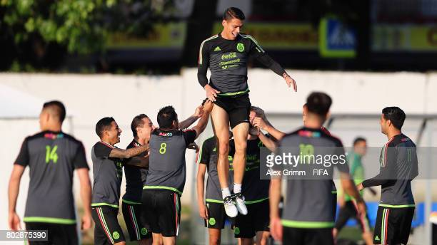 Hector Moreno is lifted up into the air by his team mates during a Mexico press conference at Fisht Olympic stadium ahead of their FIFA...