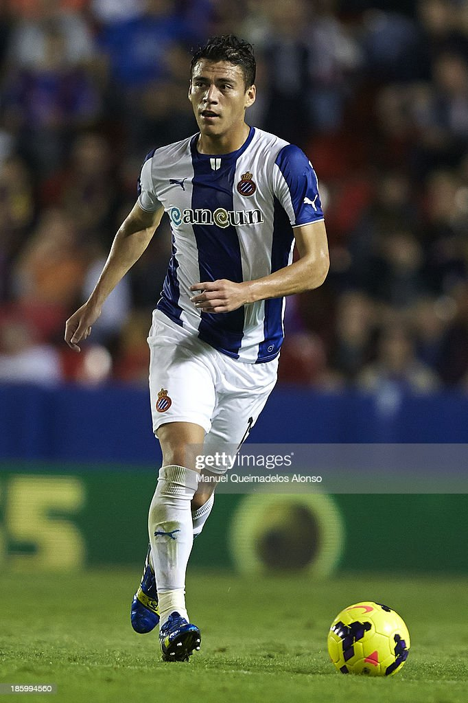 Hector Moreno of Espanyol runs with the ball during the La Liga match between Levante UD and RCD Espanyol at Estadio Ciutat de Valencia on October 26...