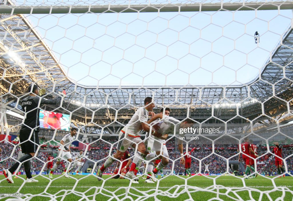 Hector Moreno of Mexico celebrates scoring his sides second goal with his Mexico team mates as Rui Patricio of Portugal reacts during the FIFA Confederations Cup Russia 2017 Group A match between Portugal and Mexico at Kazan Arena on June 18, 2017 in Kazan, Russia.