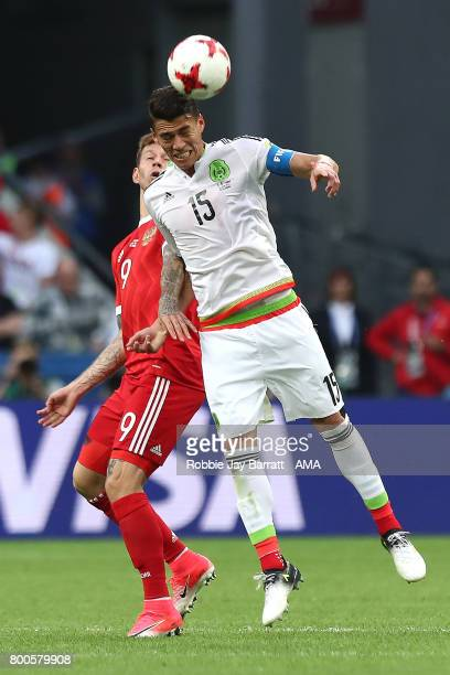 Hector Moreno of Mexico competes with Fedor Smolov of Russia during the FIFA Confederations Cup Russia 2017 Group A match between Mexico and Russia...