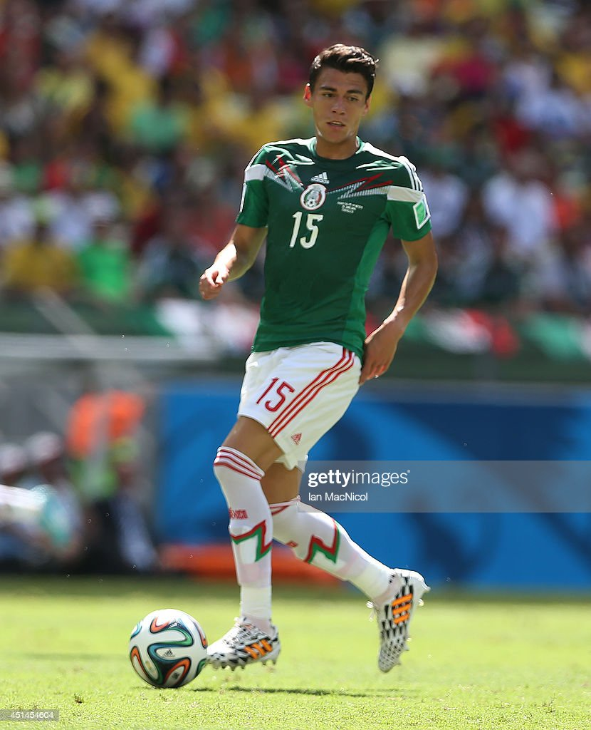 Hector Moreno of Mexico controls the ball during the Round of 16 match of the 2014 World Cup between Netherlands and Mexico at the Estadio Castelao...