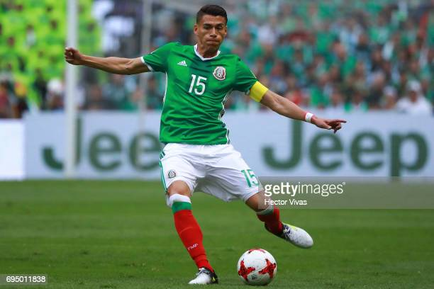 Hector Moreno of Mexico drives the ball during the match between Mexico and The United States as part of the FIFA 2018 World Cup Qualifiers at Azteca...