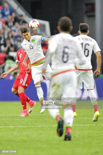 Hector Moreno of Mexico in action against Fedor Smolov of Russia during the FIFA Confederations Cup 2017 group A soccer match between Mexico and...