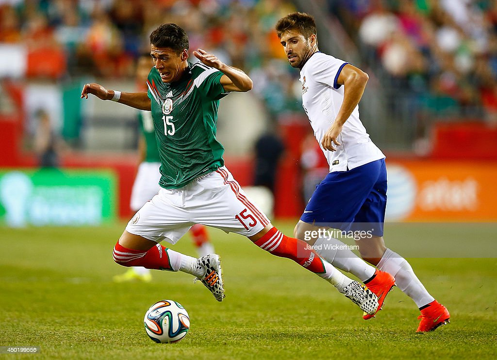 Hector Moreno of Mexico is fouled by Miguel Veloso of Portugal in the first half during the international friendly match at Gillette Stadium on June...