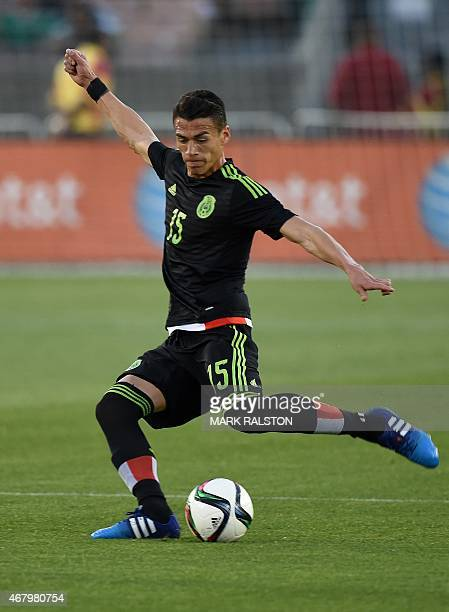 Hector Moreno of Mexico passes during a friendly football match against Ecuador at the LA Memorial Coliseum in Los Angeles California on March 28...