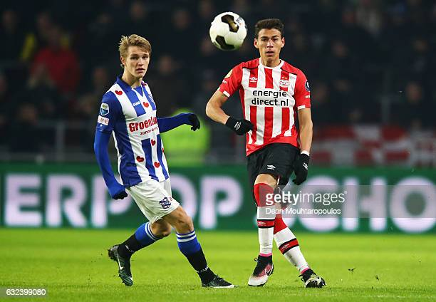 Hector Moreno of PSV clears the ball away from Martin Odegaard of sc Heerenveen during the Dutch Eredivisie match between PSV Eindhoven and SC...