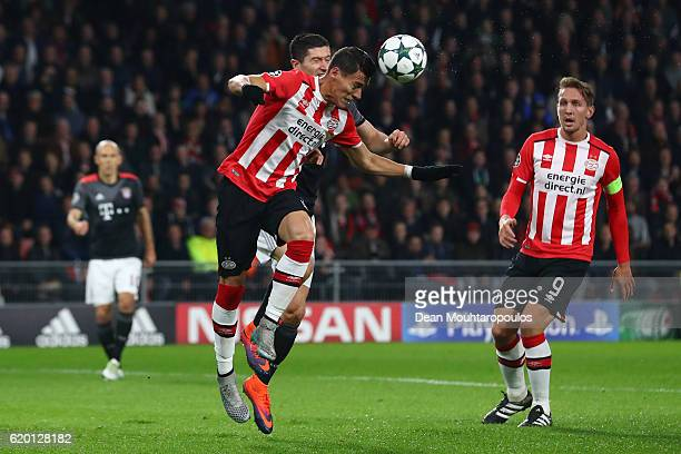 Hector Moreno of PSV Eindhoven and Robert Lewandowski of Bayern Muenchen battle for possession during the UEFA Champions League Group D match between...