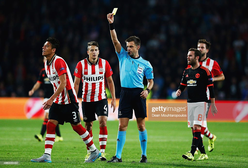 Hector Moreno of PSV Eindhoven is shown the yellow card by referee Nicola Rizzoli during the UEFA Champions League Group B match between PSV...