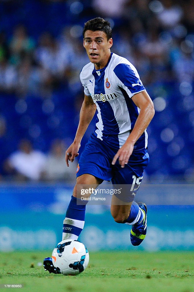 Hector Moreno of RCD Espanyol runs with the ball during the La Liga match between RCD Espanyol and Valencia CF at CornellaEl Prat Stadium on August...