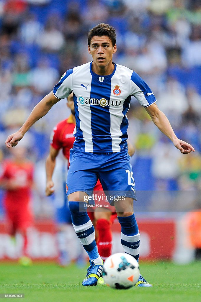 Hector Moreno of RCD Espanyol runs with the ball during the La Liga match between RCD Espanyol and Getafe CF at CornellaEl Prat Stadium on September...