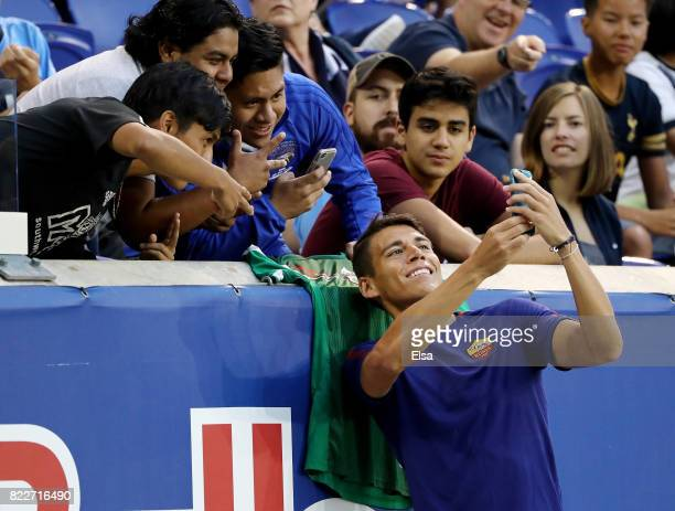 Hector Moreno of Roma takes a selfie with fans before the match against Tottenham Hotspur during the International Champions Cup on July 25 2017 at...