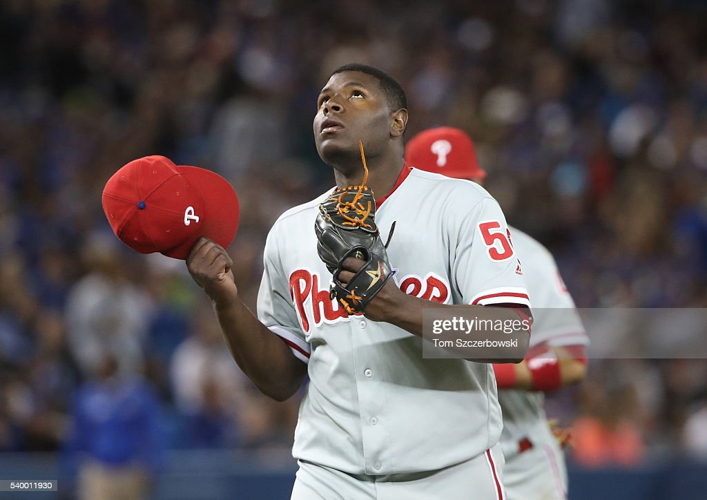 Hector Neris #50 of the Philadelphia Phillies celebrates after getting the last out of the eighth inning during MLB game action against the Toronto Blue Jays on June 13, 2016 at Rogers Centre in Toronto, Ontario, Canada.