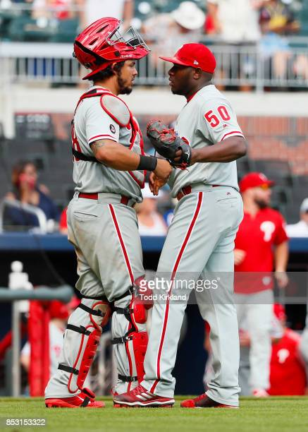 Hector Neris of the Philadelphia Phillies celebrates the victory with Jorge Alfaro in the ninth inning of an MLB game against the Atlanta Braves at...