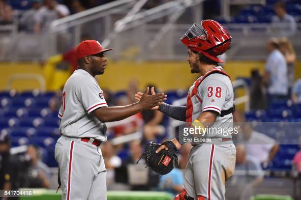 Hector Neris of the Philadelphia Phillies celebrates with catcher Jorge Alfaro after defeating the Miami Marlins at Marlins Park on September 1 2017...