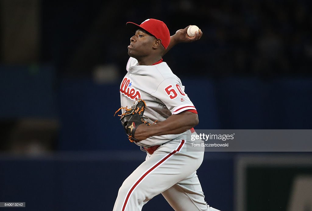 Hector Neris #50 of the Philadelphia Phillies delivers a pitch in the eighth inning during MLB game action against the Toronto Blue Jays on June 13, 2016 at Rogers Centre in Toronto, Ontario, Canada.