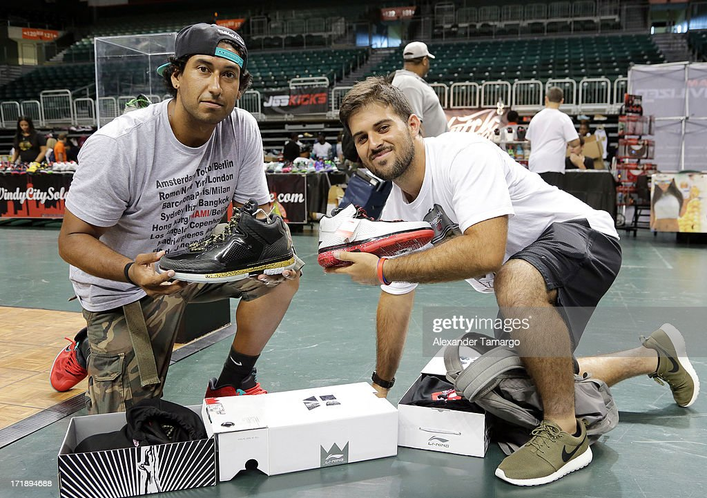 Hector Reyes and Alberto Martinez show off their limited edition Li-Ning sneakers at SneakerCon Miami 2013 at Bank United Center on June 29, 2013 in Miami, Florida.