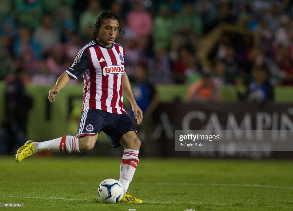 Hector Reynoso kicks the ball during a match between Leon and Chivas as part of the Apertura 2013 Liga MX at Leon Stadium on September 21, 2013 in Leon, Mexico.