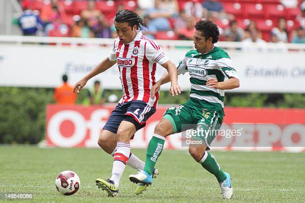 Hector Reynoso of Chivas and Herculez Gomez of Santos fight for the ball during a match between Chivas and Santos as part of the Liga MX 2012 at...